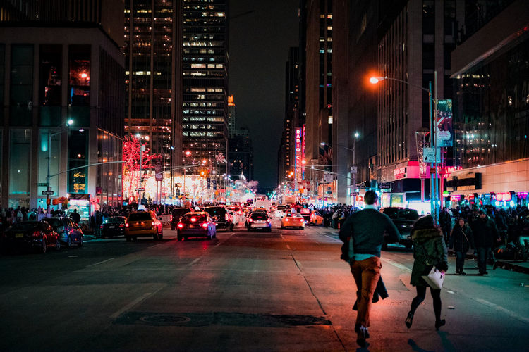 Crowd on street in city at night