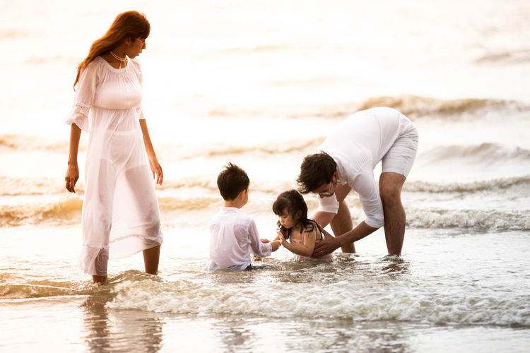 Adult Beach Child Childhood Daughter Family Females Girls Group Of People Land Males  Men Mother Offspring Parent Positive Emotion Sea Sister Son Togetherness Water Women