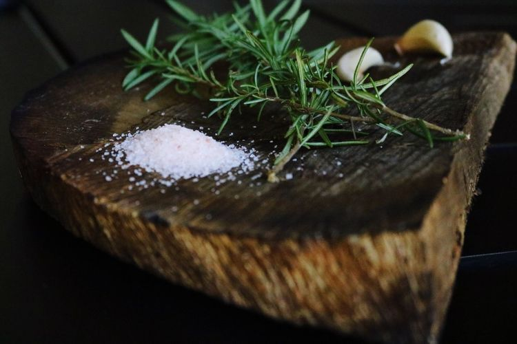 Close-up of salt with rosemary and garlic