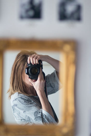 Mirror Activity Beautiful Woman Camera Camera - Photographic Equipment Digital Camera Hair Hairstyle Holding In The Mirror Indoors  Occupation One Person Photographer Photographic Equipment Photographing Photography Themes Portrait Skill  Technology Women