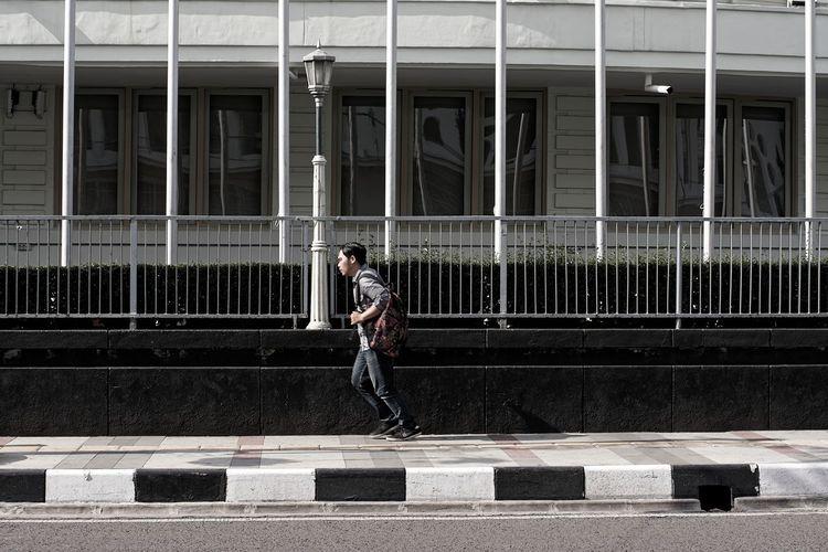 Man Running On Sidewalk