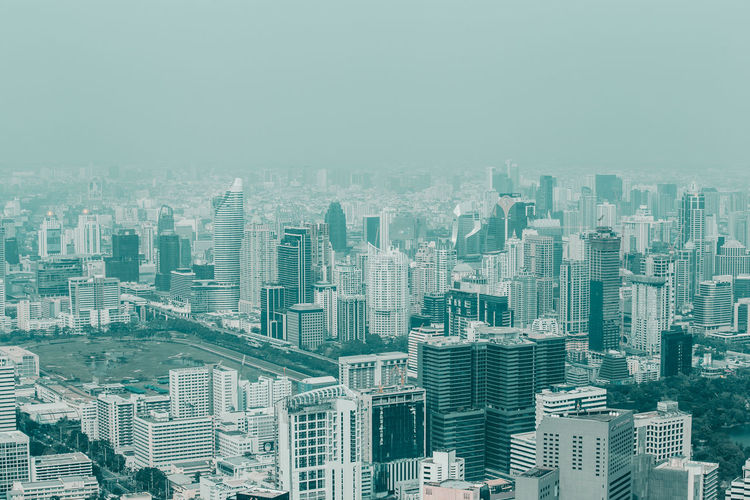 bangkok cityscape. Building Exterior Building City Cityscape Architecture Built Structure Office Building Exterior Residential District Skyscraper Crowd High Angle View Nature Sky Crowded Landscape Tower Day Outdoors Urban Skyline Apartment Housing Development