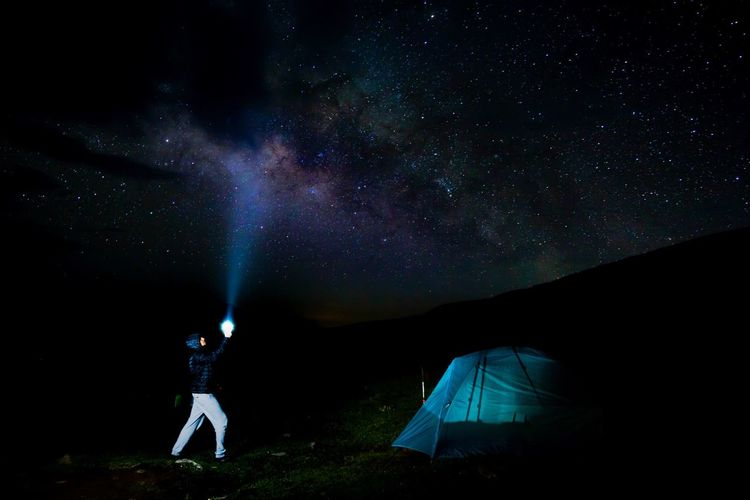 """Milky Way"" at Pathar Nachani, Garhwal, Himalayas. The Great Outdoors - 2018 EyeEm Awards The Traveler - 2018 EyeEm Awards Star - Space Night Astronomy Space Camping Sky Tent Galaxy Leisure Activity Nature Milky Way Adventure Scenics - Nature Exploration Star People Star Field Beauty In Nature Adult Illuminated"