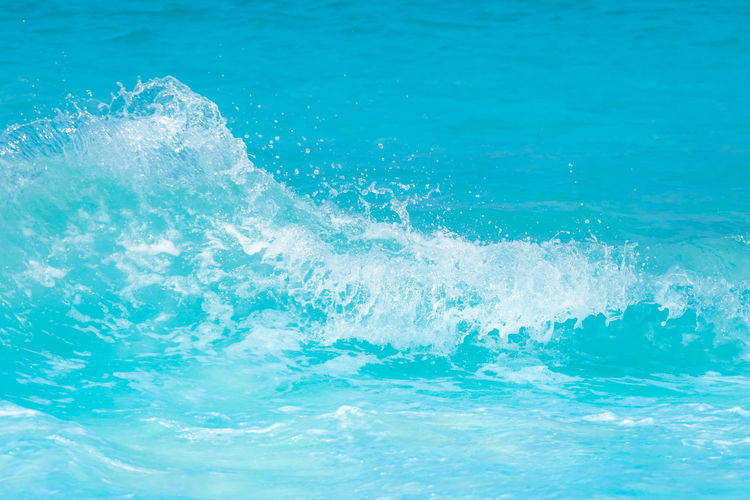 The beautiful sea wave with blue foam and turquoise color.