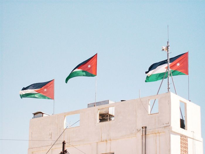 Low angle view of flag of jordan