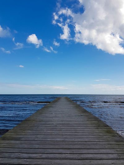 Pier over sea against sky