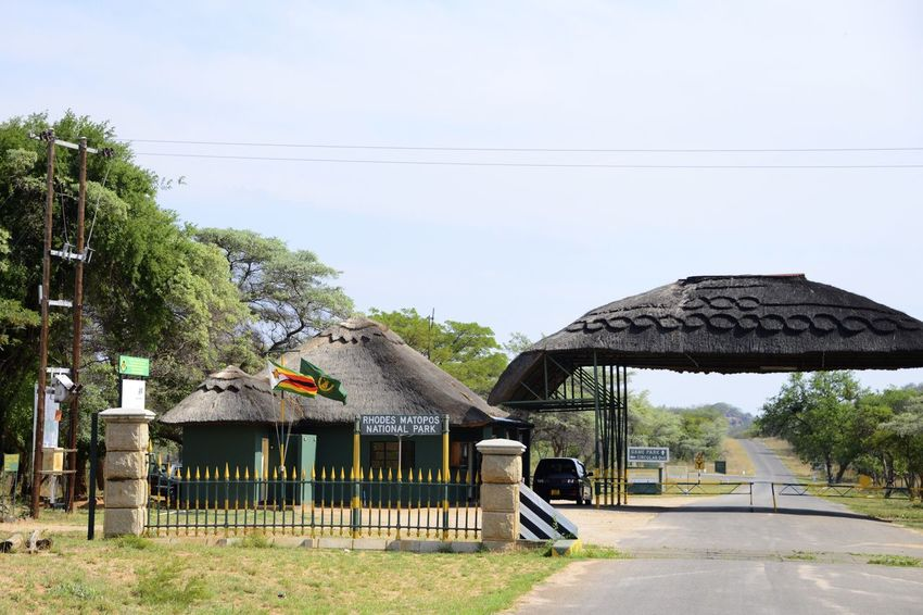 Entrance Rhodes Matopos National Park Entrance Gate MatopoHills National Park Rhodes UNESCO World Heritage Site Zimbabwe Africa Built Structure Day Nature No People Outdoors Rhodes Matopos National Park Road Tree Unesco