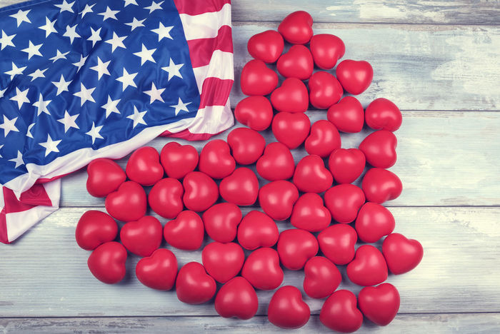 American flag and fifty red hearts 4th Of July American Flag Celebration Freedom Happy Holiday Liberty Lines Memorial National Shape USA Backgrounds Day Fifty Hearts Independance No People Red Row Stars State Striped Symbol Wooden