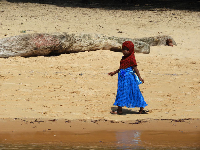 EyeEm Best Shots EyeEm Gallery Kenya Red & Blue Africa African Children Beach Child Child Walking Alone Lifestyles One Person Real People Sand Traditional Clothing Walking Watamu Water Women Working