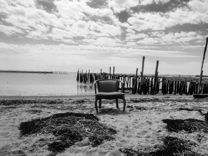 Is That A Chair? Lets Enjoy The Ocean.. Chair Ocean View Sand Fancy Blackandwhite Black And White Black & White Blackandwhite Photography Black And White Photography Seaweed Old Peer Peer Sky And Clouds Sky Sky_ Collection Sky_collection Weird Cloud - Sky Water