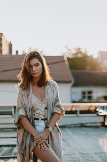 Architecture Beautiful Woman Building Exterior Built Structure Casual Clothing Day Focus On Foreground Front View Leisure Activity Lifestyles Long Hair Looking At Camera One Person Outdoors Portrait Real People Standing Young Adult Young Women