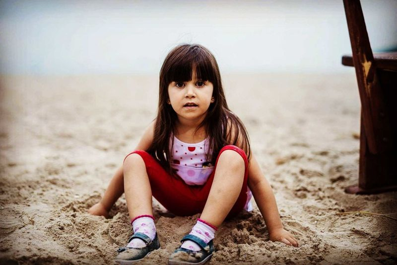 Mihaela Black Sea Varna Bulgaria Summer Childhood Play Mood Portrait Kid Portrait Photography Face EyeEm Selects Sitting Beach Child Portrait Sea Sand Depression - Sadness Front View Girls Sky Human Knee Knee