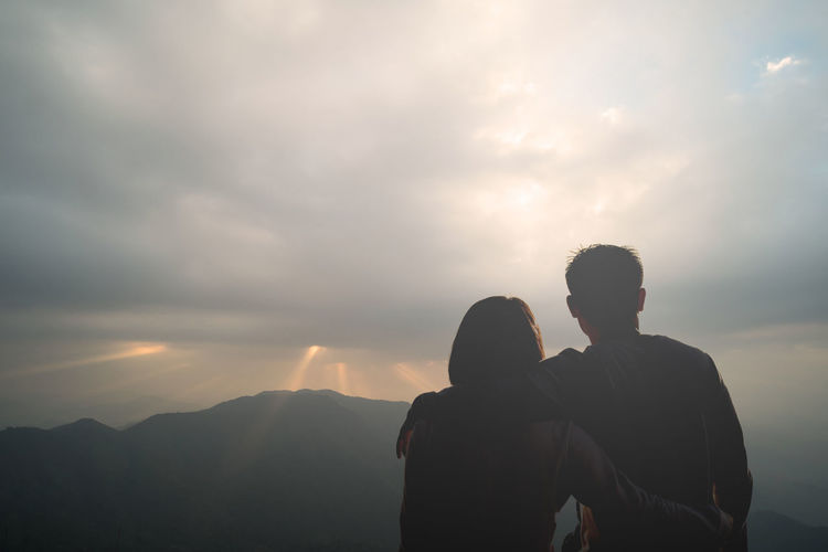 Rear view of couple against mountain s
