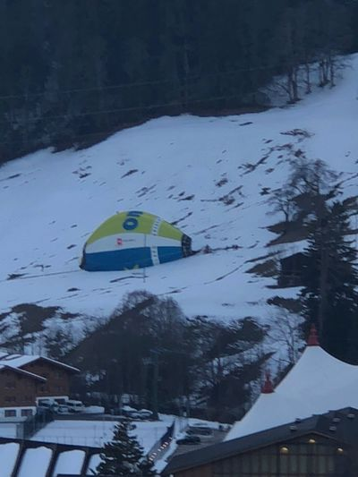 Crashed hot air balloon I❤️Gstaad Shades Of Winter Bolonie Style Bolonie Art Bolonie Snow Winter Cold Temperature Weather Leisure Activity Day Flag Mountain Nature Architecture Outdoors Real People One Person Tree Built Structure People Building Exterior An Eye For Travel