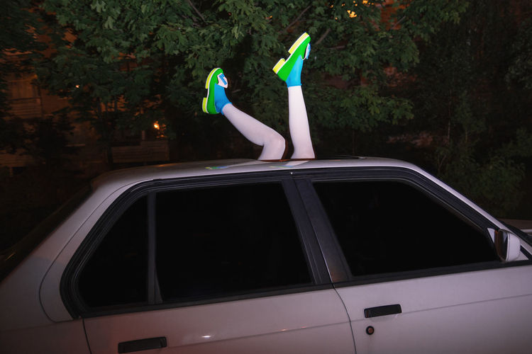 Legs protruding from car