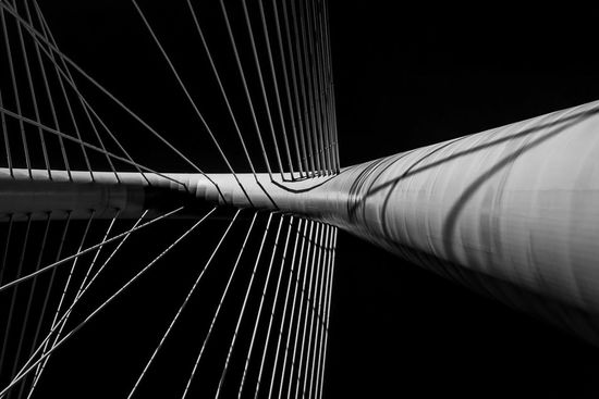 The Arch Into Space - Abstract detail of the Santiago Calatrava-designed Margaret Hunt Hill Bridge's arch and attached cables rising into the Dallas sky. Dallas Bridges Margaret Hunt Hill Bridge
