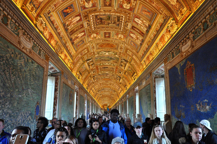 VATICAN, ITALY - MARCH 14, 2016: Tourists visiting the famous Gallery of Maps in the Vatican Museum, one of the major tourist attraction of the Vatican Museums Gallery Of Maps Tourist Tourist Attraction  Vatican Vatican Paintings VaticanCity Architecture Built Structure Churches Crowd Indoors  Large Group Of People Maps Men Real People Religion Rome Italy San Pietro Tourist Attractions Tourist Destination Vatican City Vatican Museum Visiting Visiting Museum Women