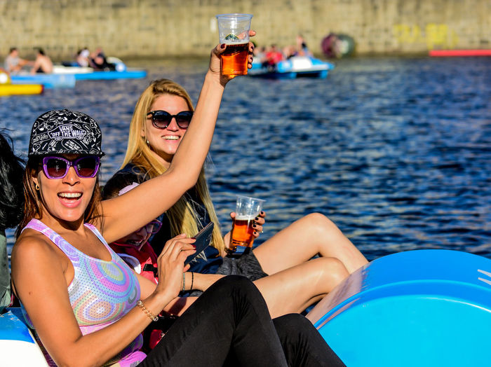 Alcohol Drink Drinking Emotion Fashion Friendship Glass Glasses Happiness Leisure Activity Lifestyles Outdoors Positive Emotion Real People Refreshment Sitting Smiling Sunglasses Togetherness Two People Water Women