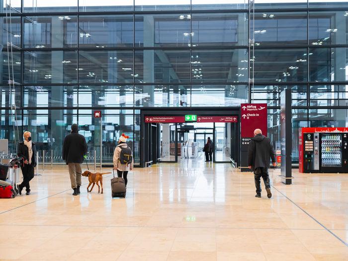 Group of people walking in airport