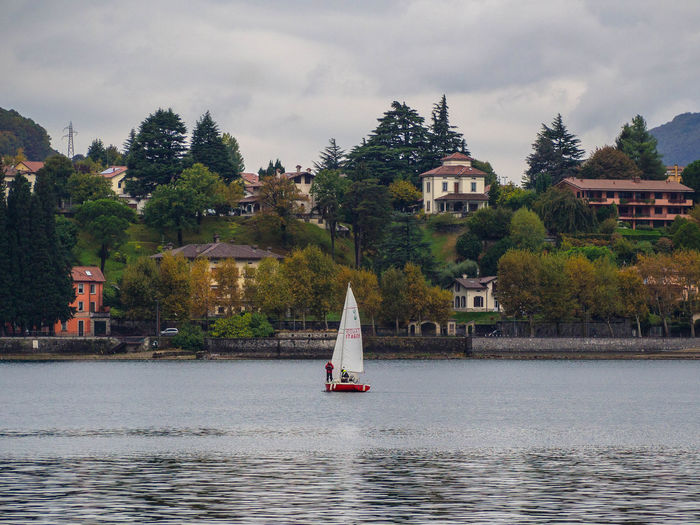 Water Tree Building Exterior Built Structure Waterfront Architecture Plant Nautical Vessel Sky Building Transportation Nature Mode Of Transportation Sailboat Day River Outdoors No People Cloud - Sky Lake View Como Lake Como Italia