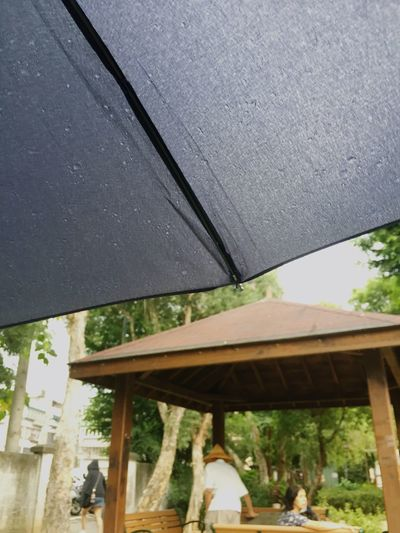 Rainy day. Architecture Built Structure Day Water Nature Outdoors Wet Umbrella Rain Men Rainy Season