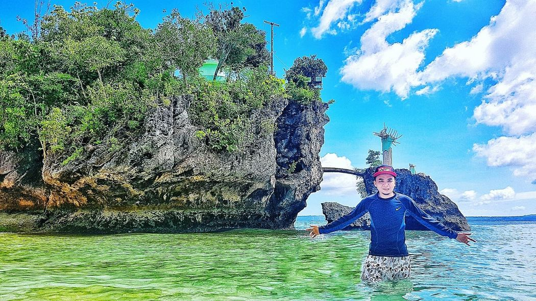 Siquijor, Philippines Siquijorisland Salagdoong Beach Cliff Jumping Beach Visayas WhenInSiquijor Mysticalisland Sky Outdoors Blue Day Green Color Only Men People Cloud - Sky Motion Adult Adults Only One Man Only Spraying Men Water One Person Nature