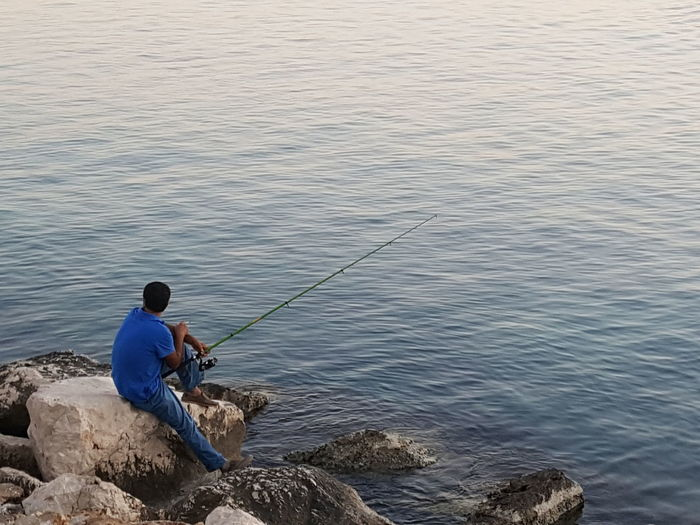 Sea Sitting Fishing Water One Person Fishing Tackle Only Men Fisherman Outdoors One Man Only Tranquility Tranquil Scene Antalya Antalya Turkey Turkey Lonesome Lonesome Fisherman Angler Lonely Lonely Fisherman Fisherman In Antalya Turkish Fisherman
