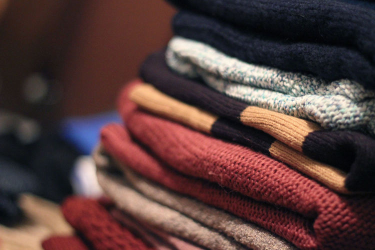 Close-up of folded sweaters