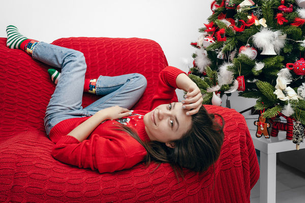 Ornaments One Woman Only Home Interior Interior Looking At Camera Holiday Couch Christmas Clothing Decoration Young Women Portrait Smiling Beautiful Woman Women Red Christmas Christmas Decoration Living Room Happiness Christmas Stocking Home Sweet Home Cozy Christmas Ornament christmas tree