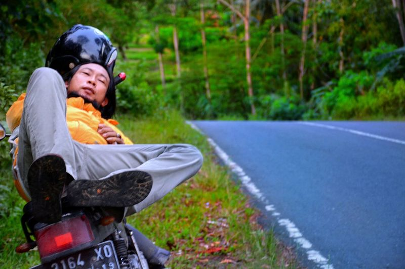 Going Everywhere!:) Enjoying Life Afternoon Alone Biker Motorcycle Sleep On A Bike Rider Cold Temperature In The Middle Of Nowhere Lost in the Landscape Love Yourself Sitting Adult People Outdoors One Person Adults Only Full Length Human Body Part Men Tree Young Adult Hair Curlers Grass Nature