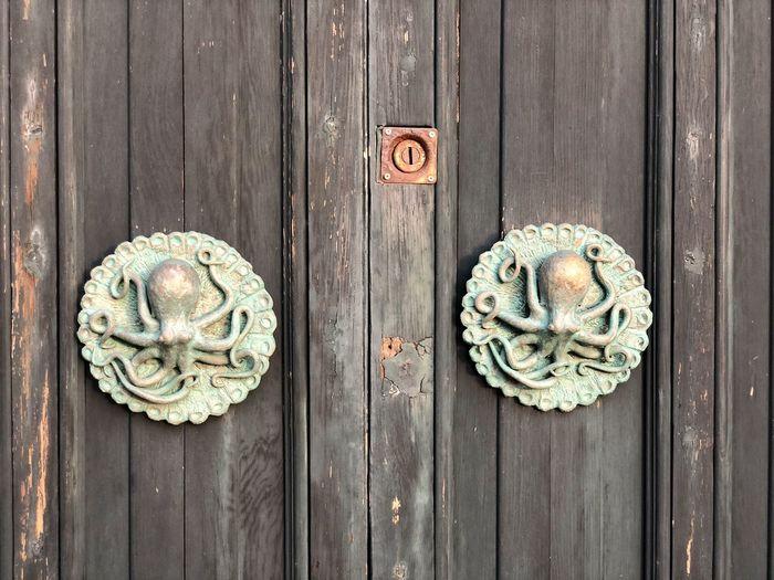 Close-up of closed door, octopus decoration