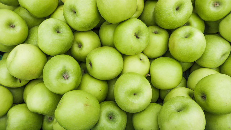 Abundance Appples Backgrounds Close-up Day Food Food And Drink Freshness Fruit Full Frame Granny Smith Apple Green Color Healthy Eating Large Group Of Objects No People Outdoors Retail