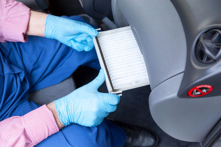 Replacing the cabin pollen air filter for a car Protection Motor Vehicle Polen Air Filter Filter Filtration Air Cabin Automobile Automotive Car Service Maintain Maintainance Automechanic Auto Mechanic Dust Replacement Replace Airflow Allergen