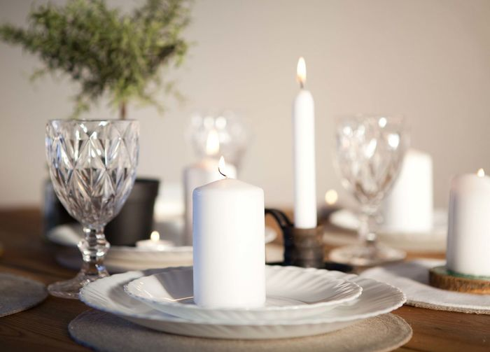 close-up of candles on table Burning Candle Close-up Day Flame Indoors  No People Place Setting Plate Table Wineglass