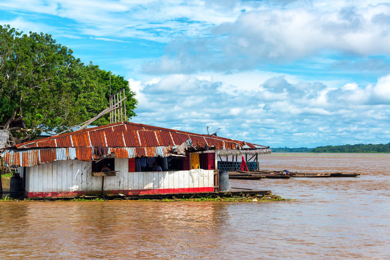 Floating shack on the Amazon River in the town of Tamshiyacu, Peru Amazon Amazon River Amazonas Amazonia Built Structure Cloud - Sky Day Float Floating Floating Shack Iquitos  Jungle Nature No People Outdoors Peru Rain Forest Rainforest River Shack Sky South America Tamshiyacu Tree Water