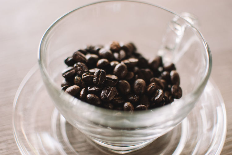 Food And Drink Food Indoors  Large Group Of Objects Close-up Roasted Coffee Bean Still Life Table Coffee - Drink Freshness Coffee Glass - Material No People Glass Transparent Bowl Abundance Drink Selective Focus Brown Crockery Caffeine Breakfast