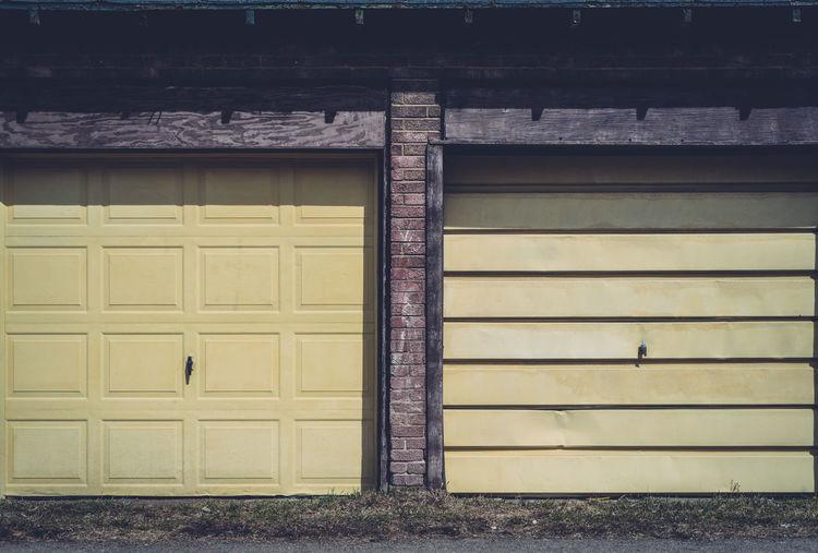 Closed yellow doors of garage
