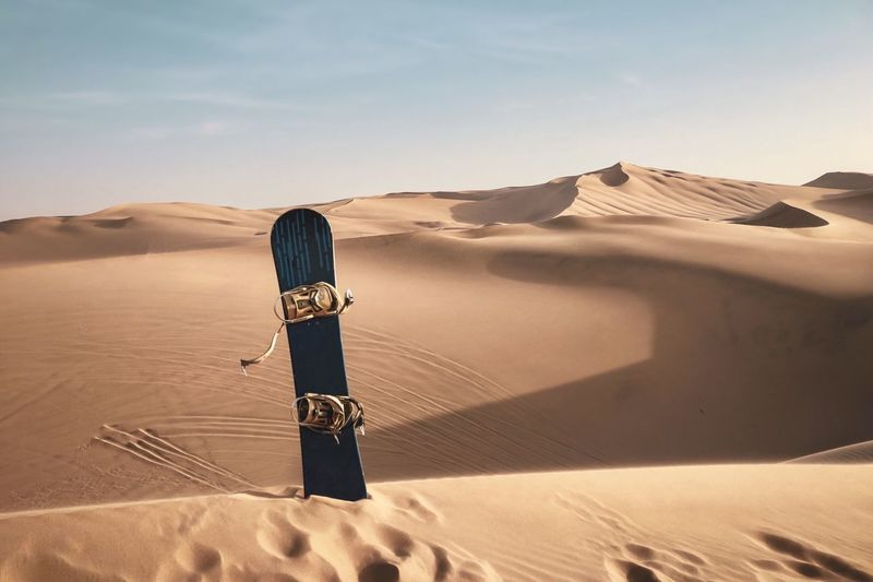 Scenic view of a sand board against desert and sky