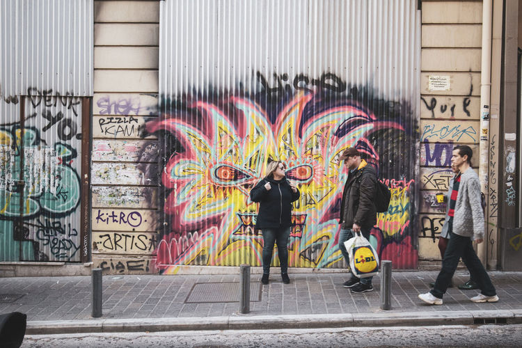 Athens Athens Greece Athens, Greece Creativity Graffiti Architecture City Full Length Art And Craft Text Motion Men Multi Colored Adult Building Exterior People Street Real People Standing Women Built Structure Two People Walking Outdoors