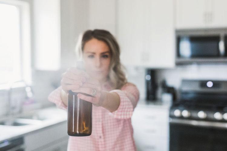 Portrait of woman drinking water from bottle
