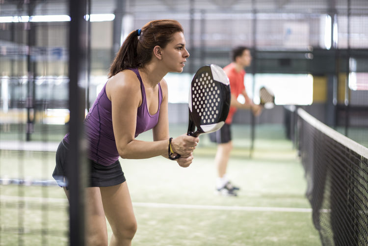 Woman Playing Paddle Tennis On Court