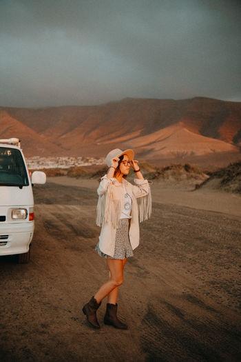 Woman standing on a desert