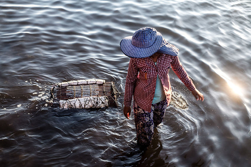 Fisherwoman at Crab Market Psar K'Dam, Kep | Cambodia. ASIA Beauty In Nature Cambodia Color Crab Culture Documentary Photography Fisherman Market Nature One Person People Real People Sea The Photojournalist - 2017 EyeEm Awards Water Women
