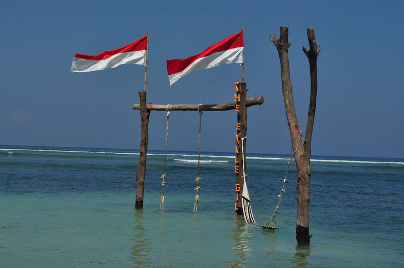 Gili Exile Gili Islands Gili Trawangan Gili Trawangan 2016 Gili Trawangan Beach North Lombok Island - Indonesia . Giliislands Gilitrawangan  INDONESIA Indonesia 2016 Indonesian Flag Island Life Islandlife Water Swing Flag Sea Gili Paradise
