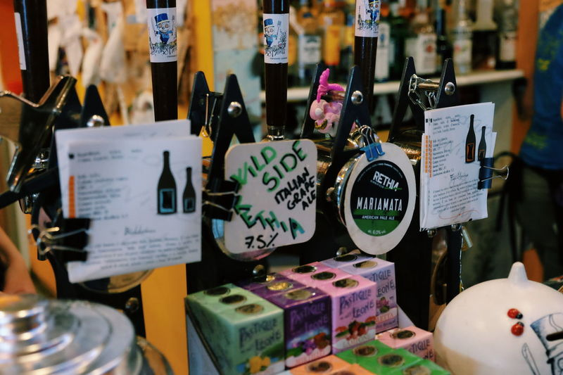Italian Craft Beer scene is flourishing, like grapes ;) //Text Large Group Of Objects Variation Communication For Sale Choice Retail  Price Tag No People Collection Indoors  Arrangement Close-up Hanging Day Food On Tap FUJIFILM X-T10 XF18-55mmF2.8-4 R LM OIS F/3.2 ISO 4000 1/60 Sec via Fotofall