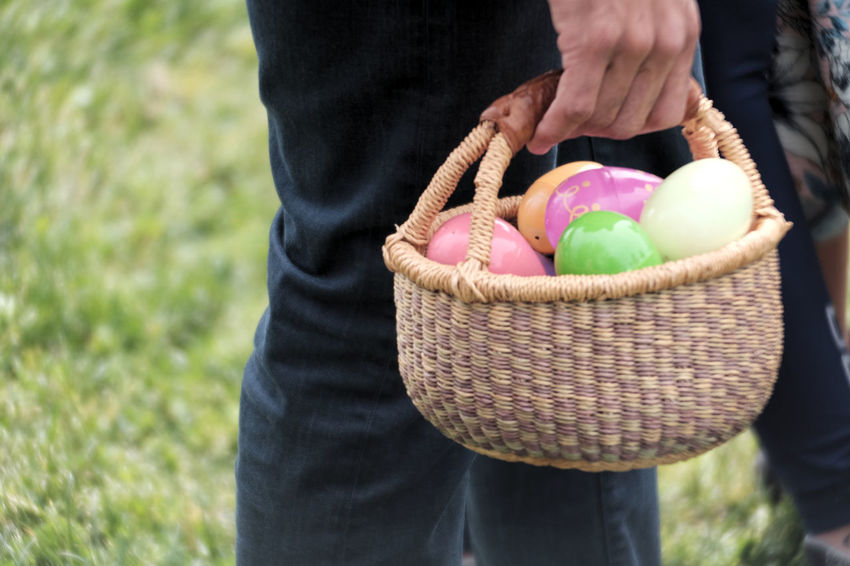 Close up on a basket full of Easter Eggs Basket Chocolate Close-up Day Easter Eggs Easter Hunt Food Food And Drink Freshness Holding Human Body Part Human Hand Midsection One Person Outdoors People Standing