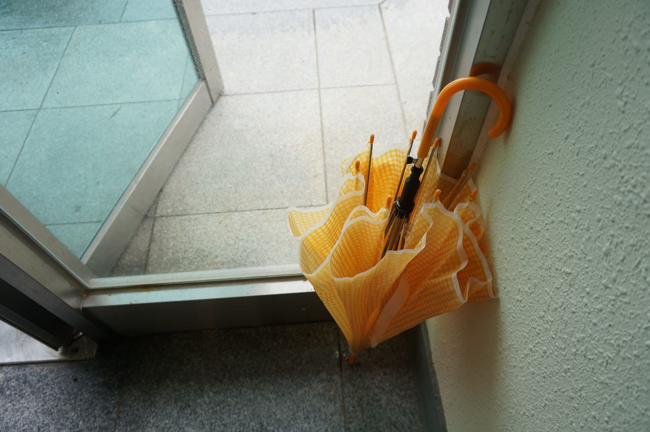 High angle view of umbrella by doorway