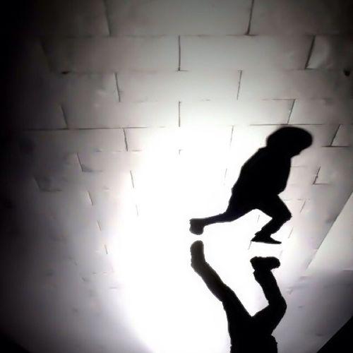 Silhouette of woman in dark