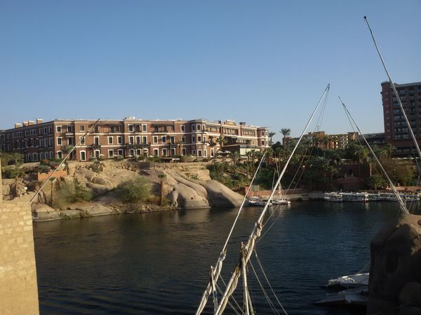 the old cataract hotel from the nile river hand in Aswan , Egypt Hotel Historical Building Nile River Aswan Egypt No People Outdoors Sky Tree Tourism Tourist Touristic Historical Hotel View Landscape Aswan, Egypt Egyptphotography
