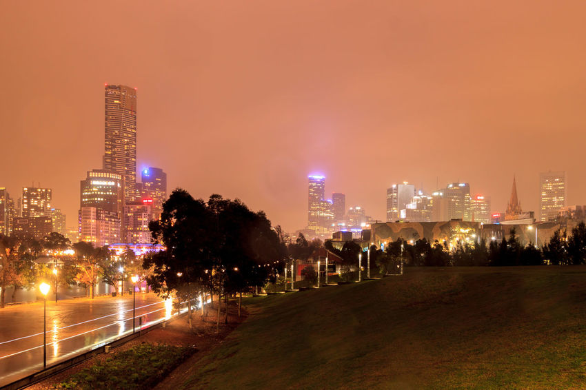 The Melbourne CBD in the middle of a storm Rain Architecture Building Building Exterior Built Structure City City Life Cityscape Financial District  Illuminated Landscape Modern Nature Night No People Office Building Exterior Outdoors Sky Skyscraper Street Travel Destinations Tree Urban Skyline Wet